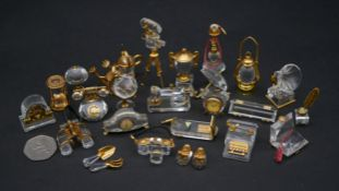 A collection of twenty five Swarovski crystal memories with gilt metal detailing. Including a
