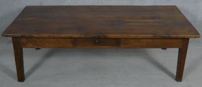 A 19th century French fruitwood low table with frieze drawer on square tapering supports. H.45 L.150
