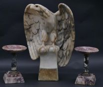 A marble eagle perched with open wings on a plinth base along with a pair of 19th century marble and