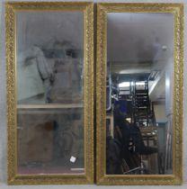 A pair of pier mirrors in scrolling foliate gilt frames. H.145.5 W.69cm