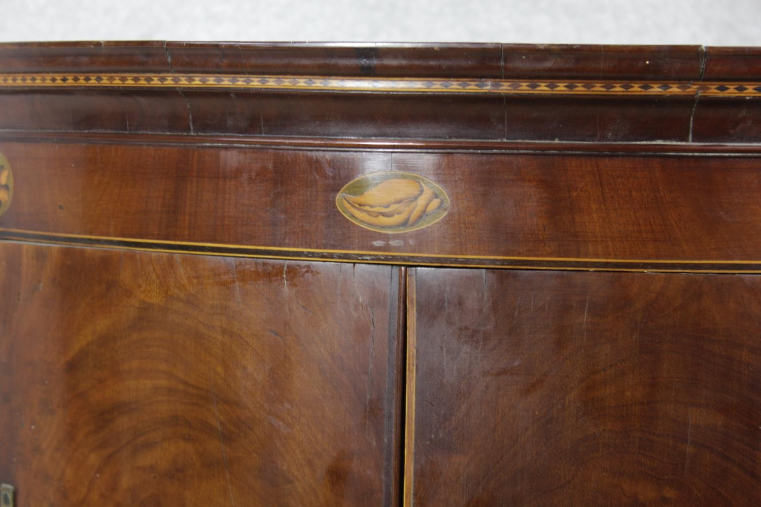 A Georgian figured mahogany bowfronted corner cupboard with satinwood and olivewood conch and floral - Image 7 of 14
