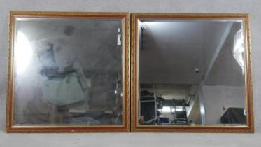 A pair of bevelled glass wall mirrors in floral decorated gilt and painted frames. H.112.5 W.112.5cm