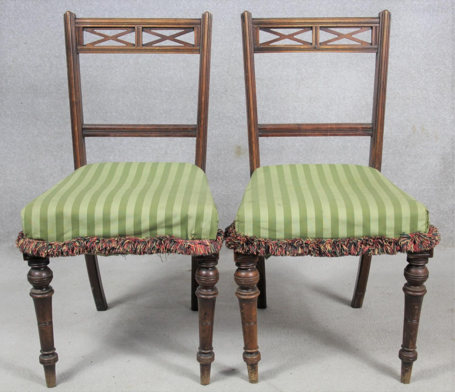 A pair of late 19th century mahogany bedroom chairs on turned tapering supports. H.87 W.48 D.50cm