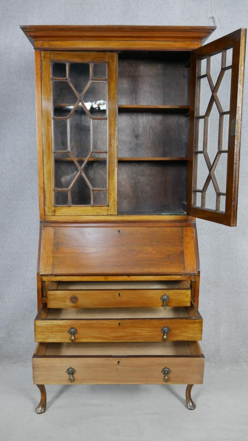 An early 20th century mahogany two section Georgian style bureau bookcase with fitted interior on - Image 2 of 8