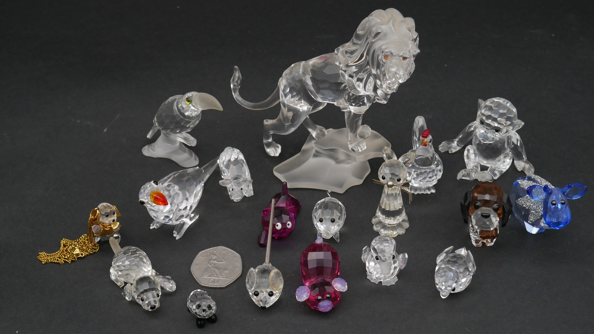 A collection of seventeen Swarovski cut crystal miniature animals to include a roaring lion, - Image 2 of 10