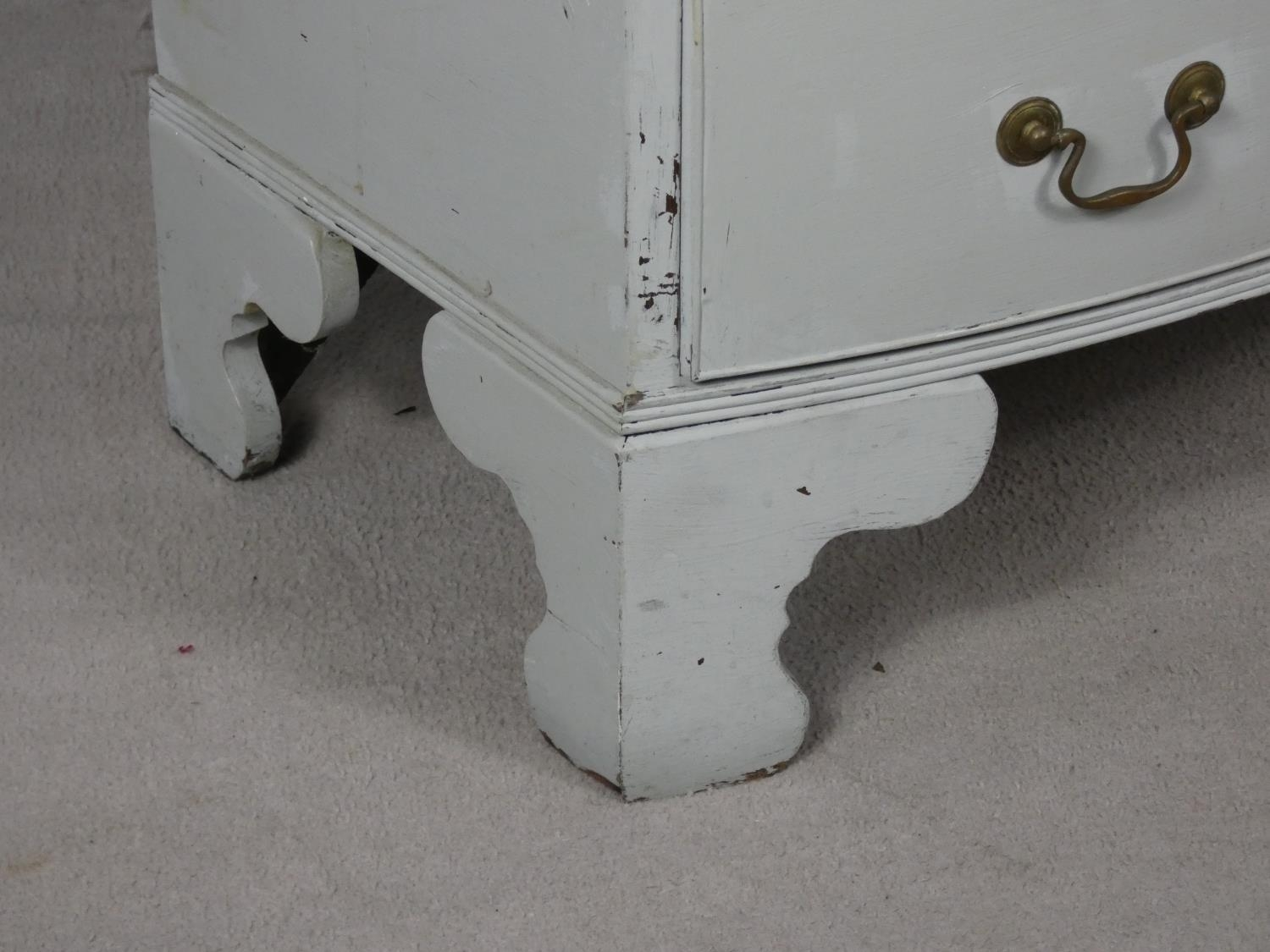 A Georgian style white painted bowfronted chest of drawers with brushing slide and brass swan neck - Image 3 of 10