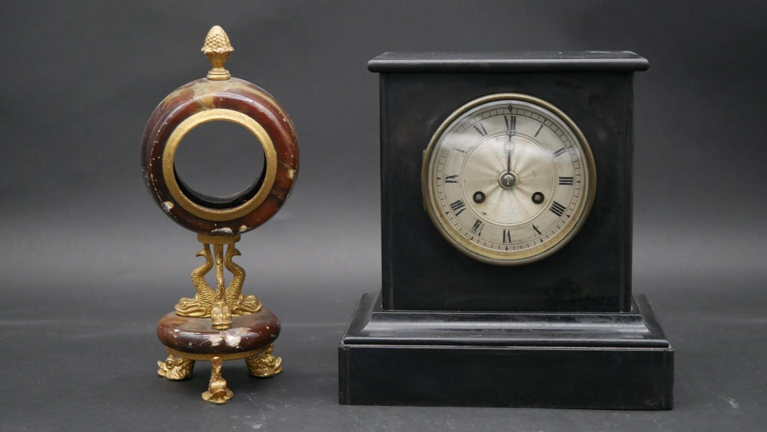 An ormolu and marble clock case on triple Trafalgar dolphin support and feet along with a late