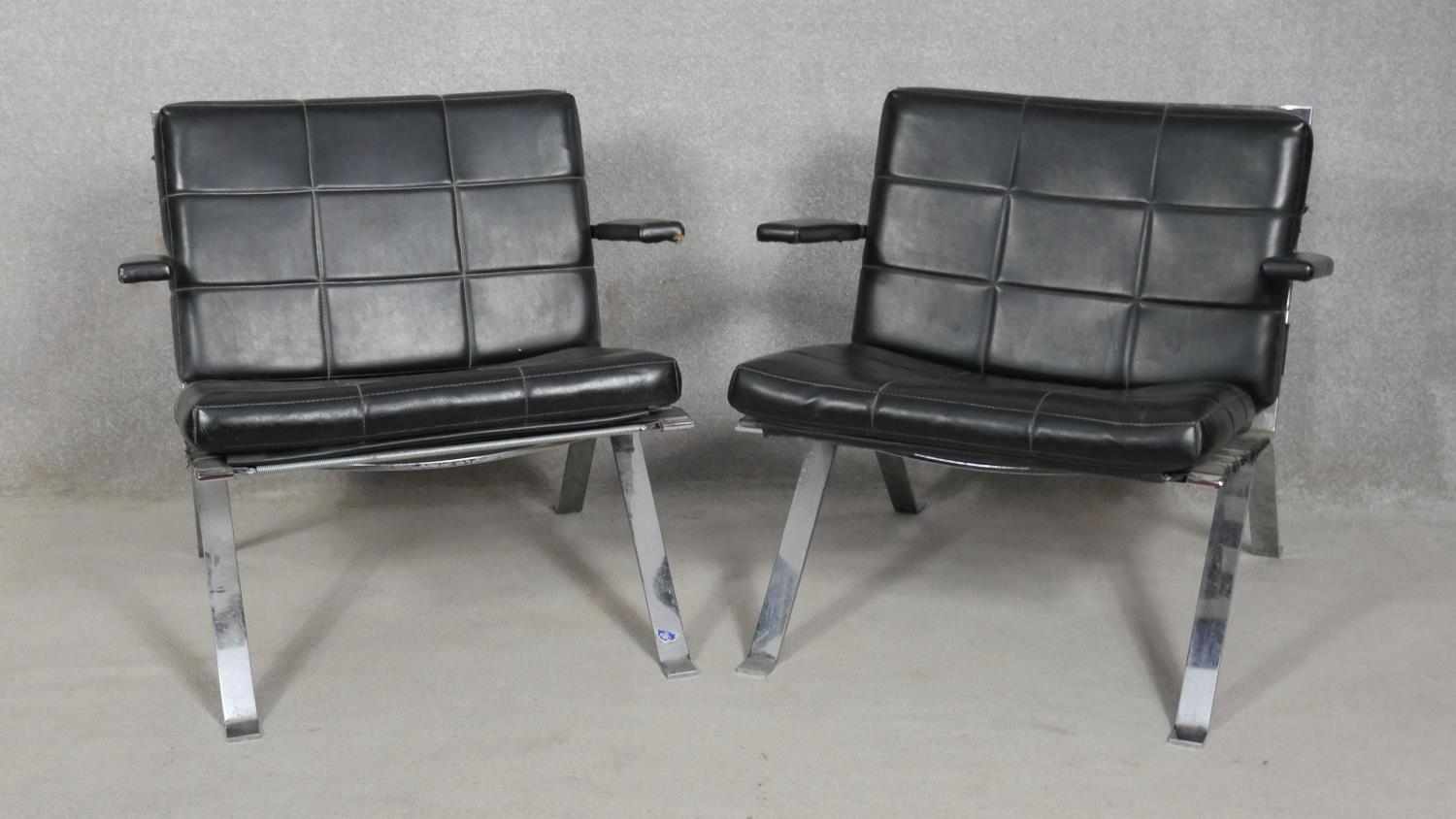 A pair of vintage leather upholstered salon chairs on chrome bases. H.68cm