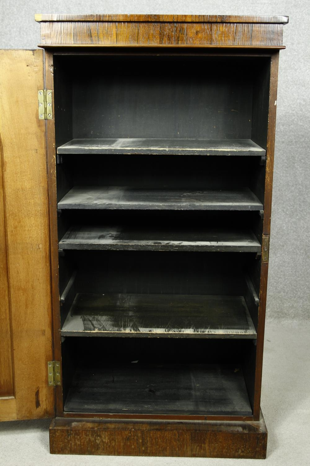 An early Victorian rosewood pier cabinet with arched panel door enclosing shelves on plinth base. - Image 6 of 11