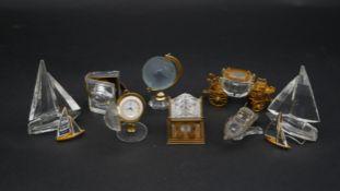 A collection of ten Swarovski crystal memories. Including a Swarovski crystal Memories secrets globe