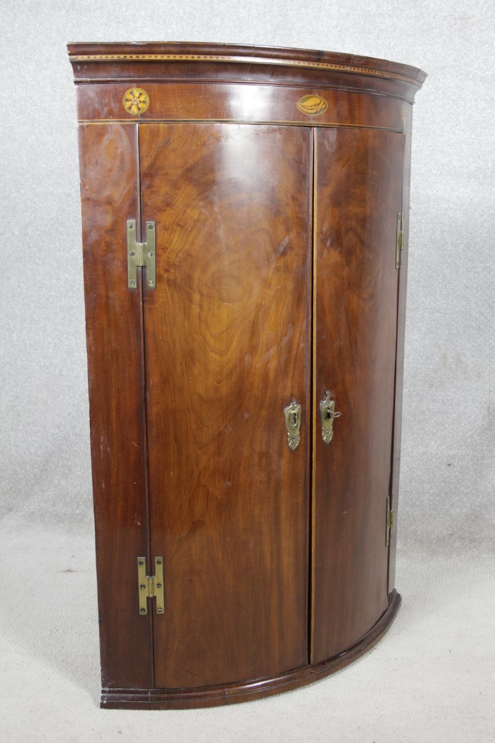 A Georgian figured mahogany bowfronted corner cupboard with satinwood and olivewood conch and floral - Image 2 of 14