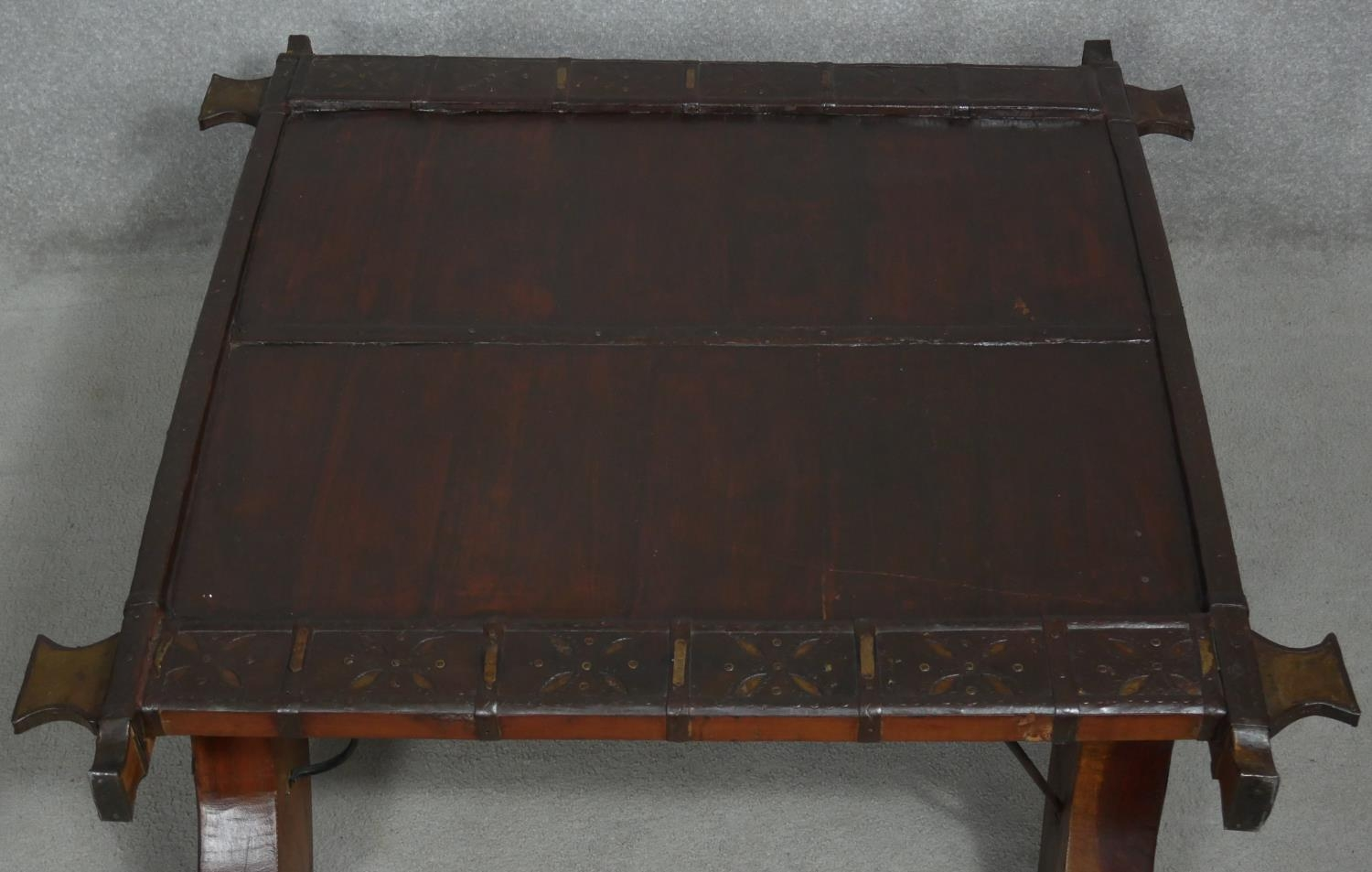 An Eastern hardwood metal bound coffee table on shaped swept supports. H.36 L.103 W.98cm - Image 5 of 5