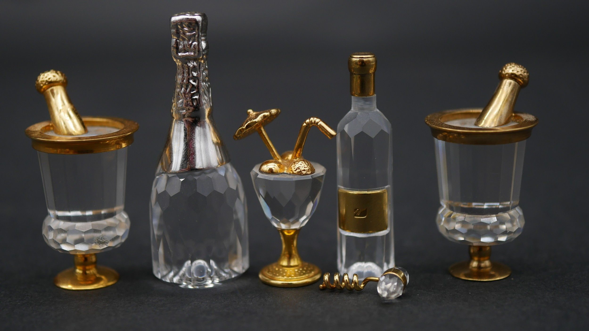 A collection of twenty three Swaovski crystal memories with gilt metal detailing and display - Image 3 of 7