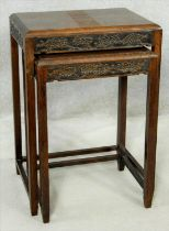 A nest of two Chinese carved hardwood occasional tables. H.56 W.46 D.35