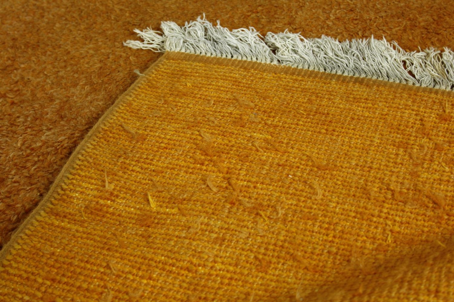 A large 1970's vintage woollen carpet in tangerine retailed by Heal's. L.380 W.280cm - Image 3 of 3