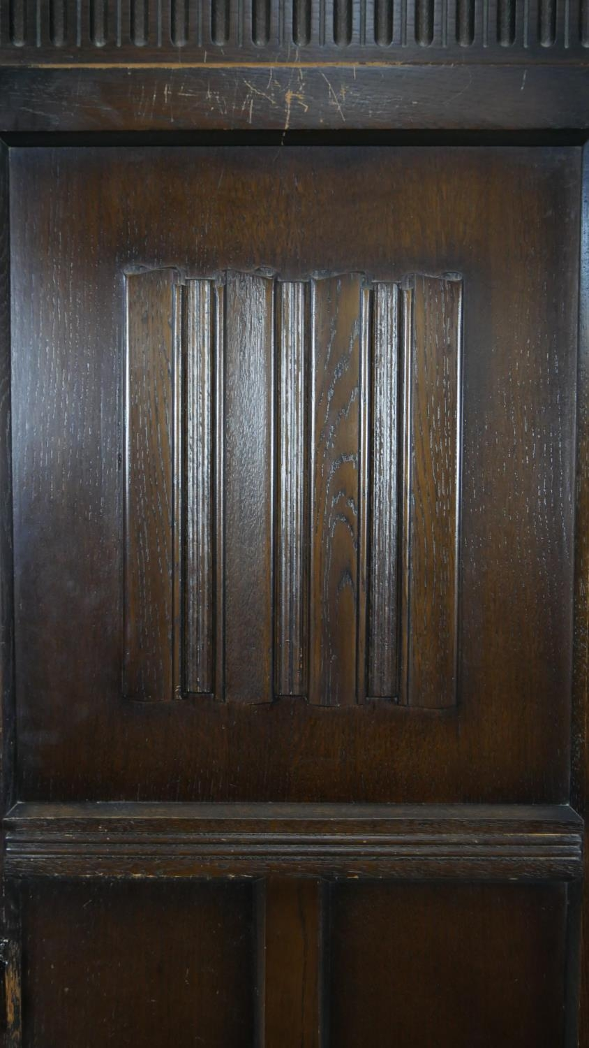 A mid century oak Jacobean style floor standing hall cupboard with carved linenfold panel door on - Image 7 of 9