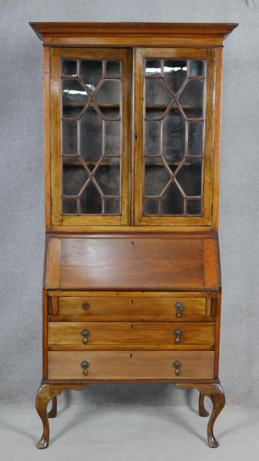 An early 20th century mahogany two section Georgian style bureau bookcase with fitted interior on
