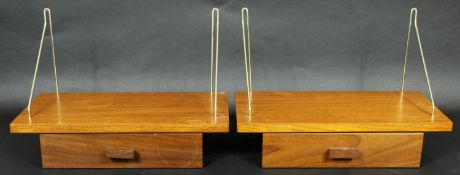 A pair of vintage teak hanging wall shelves fitted with frieze drawers. H.26 W.40 D.21cm