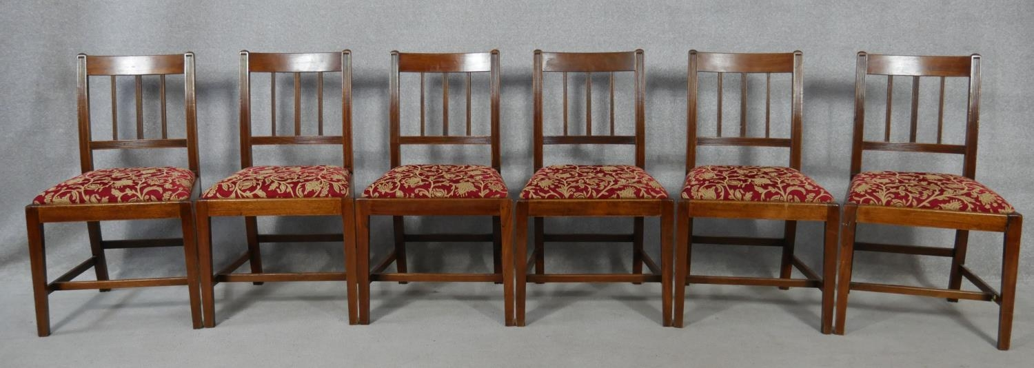 A set of six 19th century mahogany bar back dining chairs with reeded slats above drop in seats on