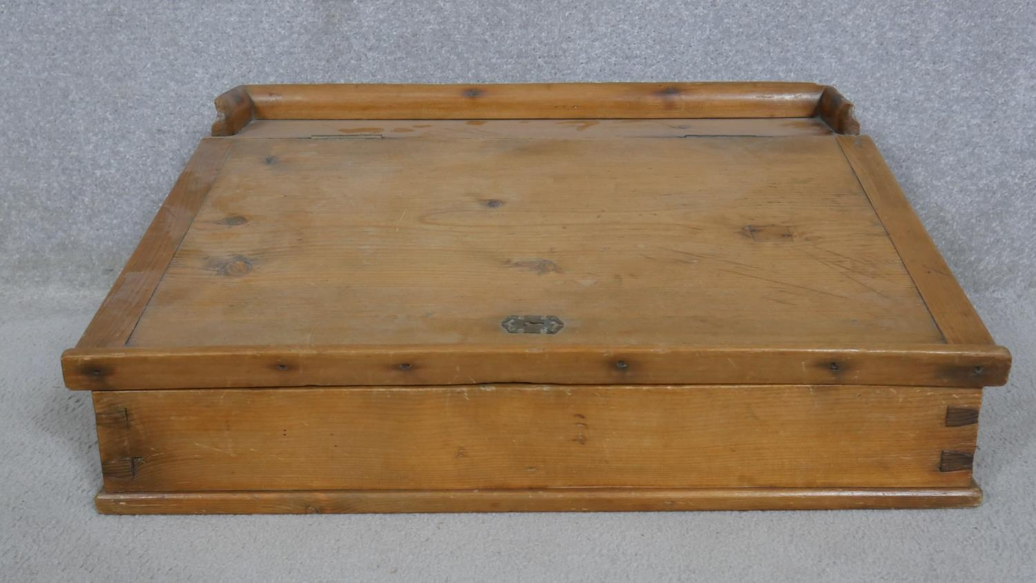 A pine clerk's writing slope with galleried top and hinged lid enclosing storage compartment. H.23