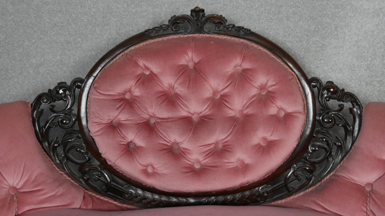 A Victorian carved walnut framed sofa in deep buttoned velour upholstery on fluted tapering - Image 2 of 6