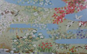A Chinese woodblock print, exotic birds and blossom in a floral lakeland setting with hand gilded