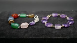 Two gemstone chain link bracelets. One with polished rectangular amethyst beads on yellow metal wire