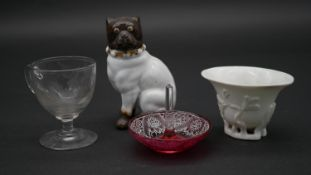 A collection of antique glass and ceramics. Including a porcelain bulldog, an engraved posset glass,