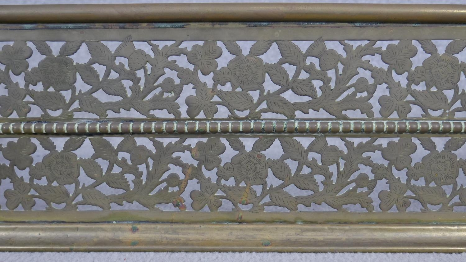 A 19th century pierced floral decorated fire fender. H.18.5 W.125 D.30cm - Image 3 of 4