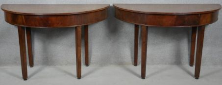 A Georgian mahogany dining table with two D-ends to form a circular table (it comes with original