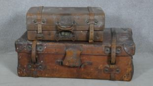A vintage leather cabin trunk along with a similar case. H.52 L.92 W.31cm (Largest)