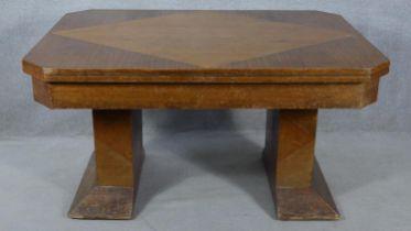 A mid century Art Deco style oak, teak and walnut segment veneered draw leaf dining table H.76 L.251