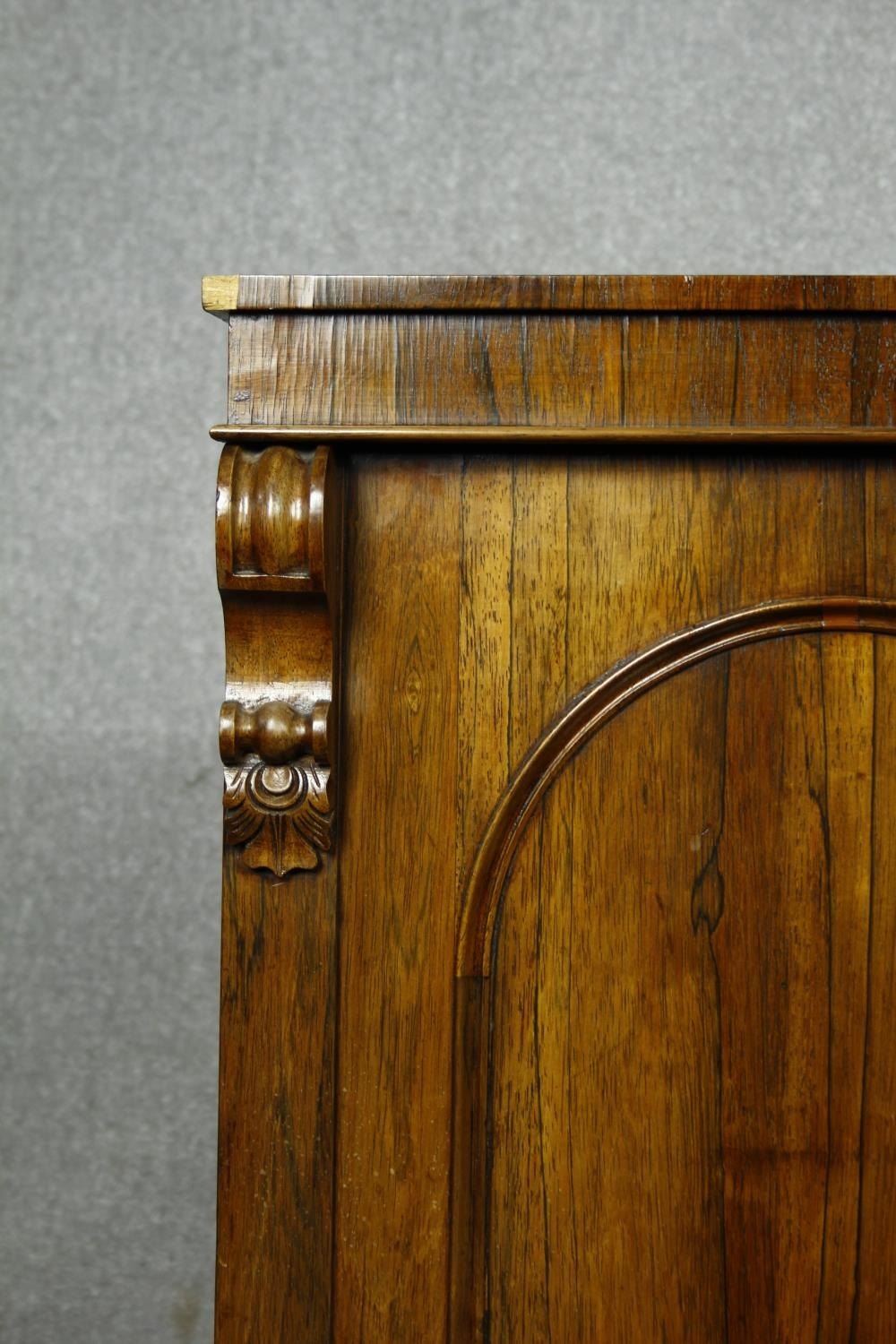 An early Victorian rosewood pier cabinet with arched panel door enclosing shelves on plinth base. - Image 7 of 11