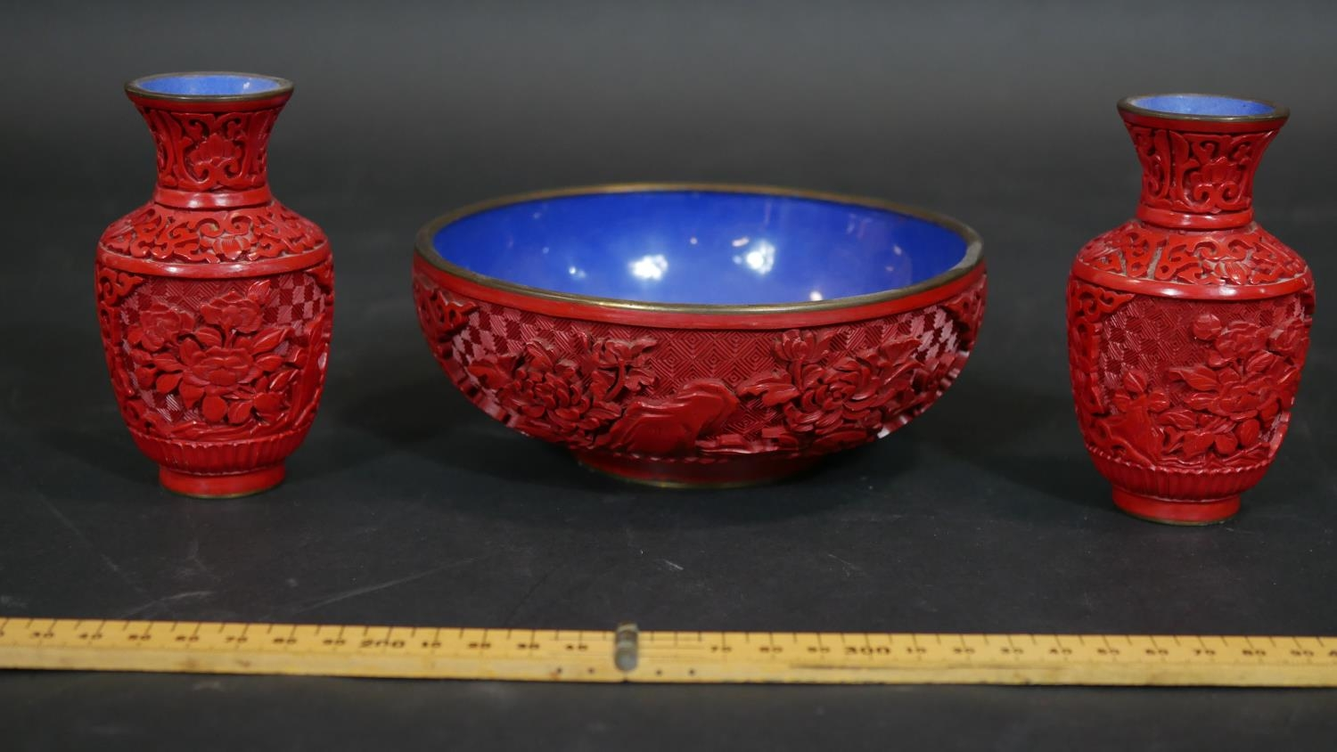 A Chinese carved cinnabar lacquer bowl with blue enamel interior and a pair of similar vases. Dia. - Image 2 of 9