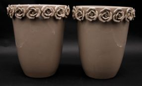 A pair of contemporary ceramic glazed vases with sculpted roses around the rim. H.25cm