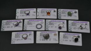 Ten silver gemstone set rings with certificates. To include a kyanite full eternity ring, a