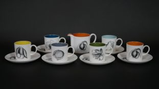 A Susie Cooper for Wedgwood coffee set, Black Fruit pattern, marked to base; six coffee cans and