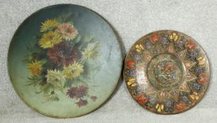 A large 19th century hand decorated oil on metal floral wall hanging display dish and an Eastern