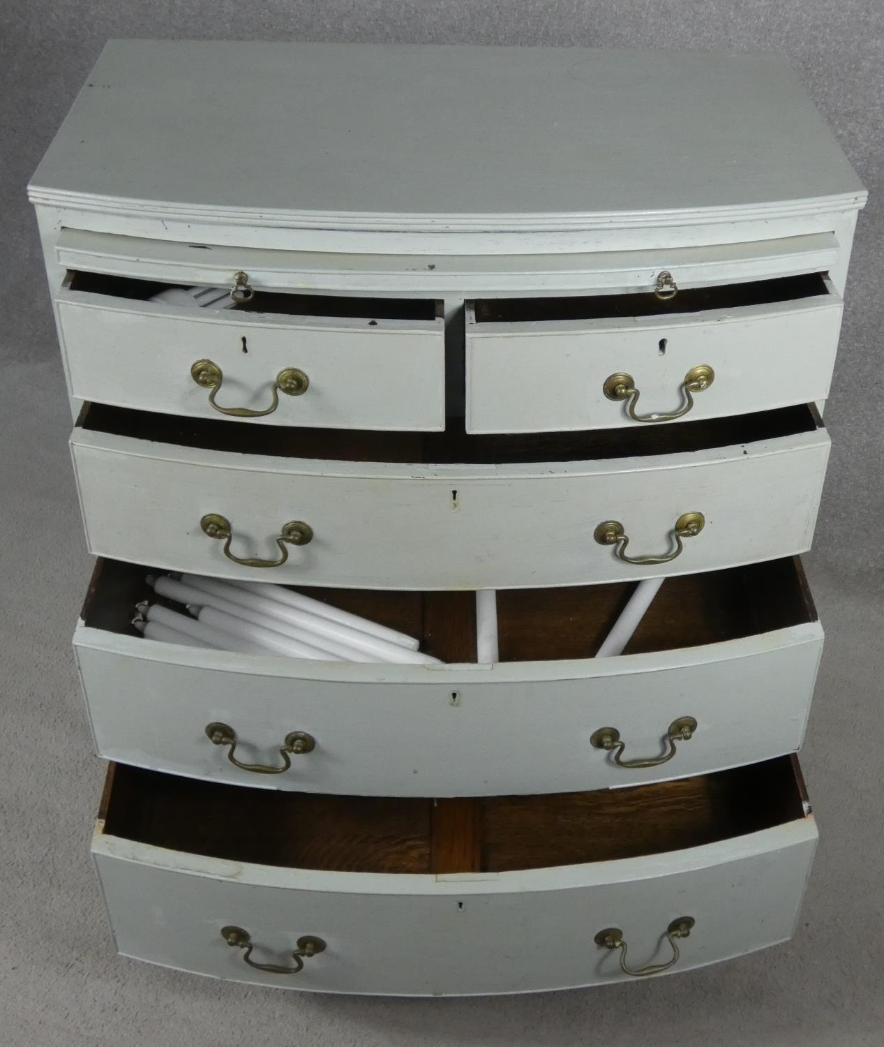 A Georgian style white painted bowfronted chest of drawers with brushing slide and brass swan neck - Image 5 of 10