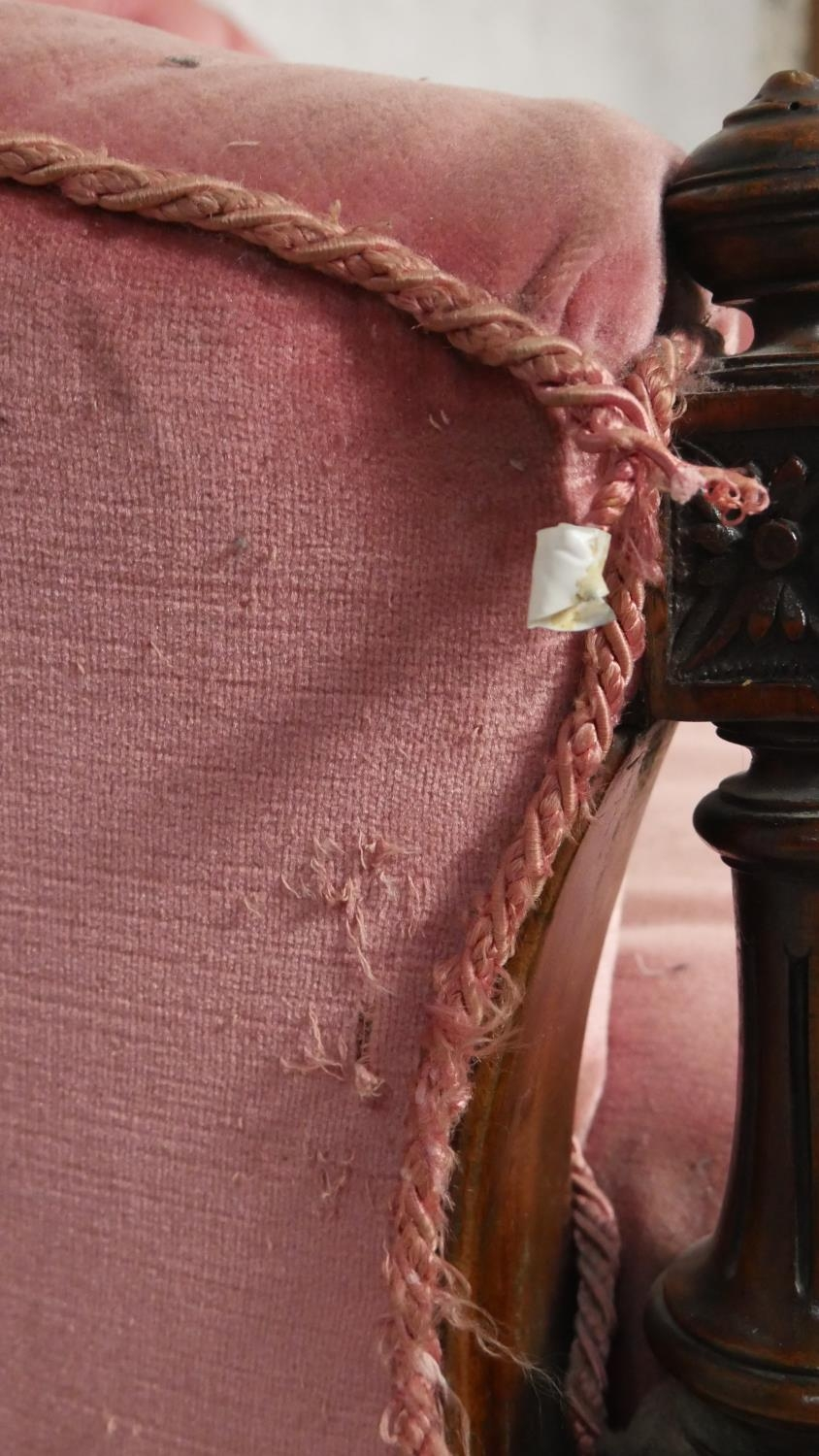 A Victorian carved walnut framed sofa in deep buttoned velour upholstery on fluted tapering - Image 4 of 6
