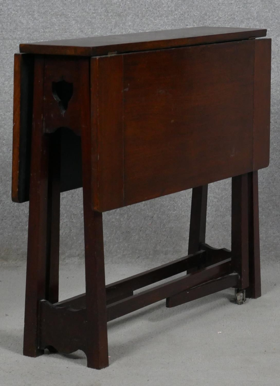 A late 19th century Art and Crafts walnut drop flap Sutherland table. H.57 L.69 W.64cm