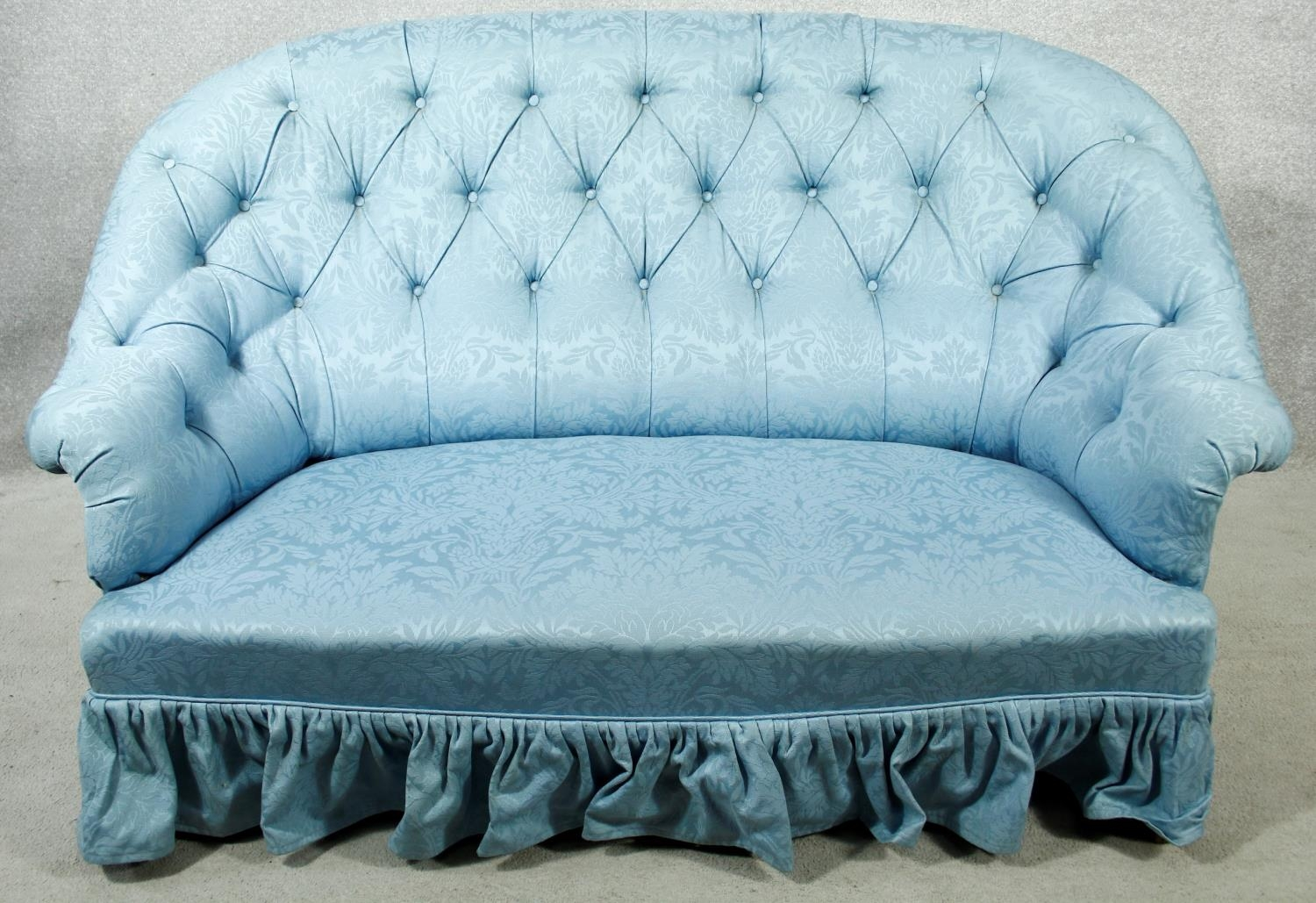 A vintage tub shaped two seater sofa in deep buttoned damask upholstery. H.94 W.150 D.90cm