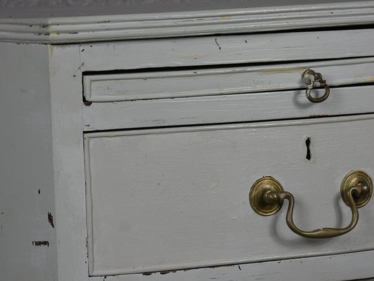 A Georgian style white painted bowfronted chest of drawers with brushing slide and brass swan neck - Image 4 of 10