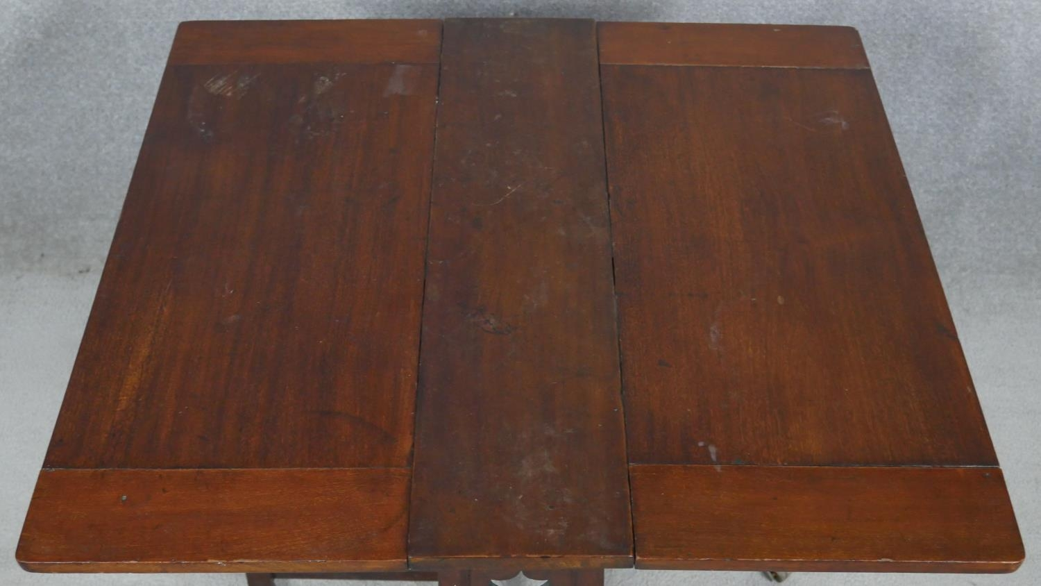 A late 19th century Art and Crafts walnut drop flap Sutherland table. H.57 L.69 W.64cm - Image 3 of 4