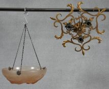 An Art Deco style opaque glass ceiling light pendant shade and a vintage gilt metal ceiling light