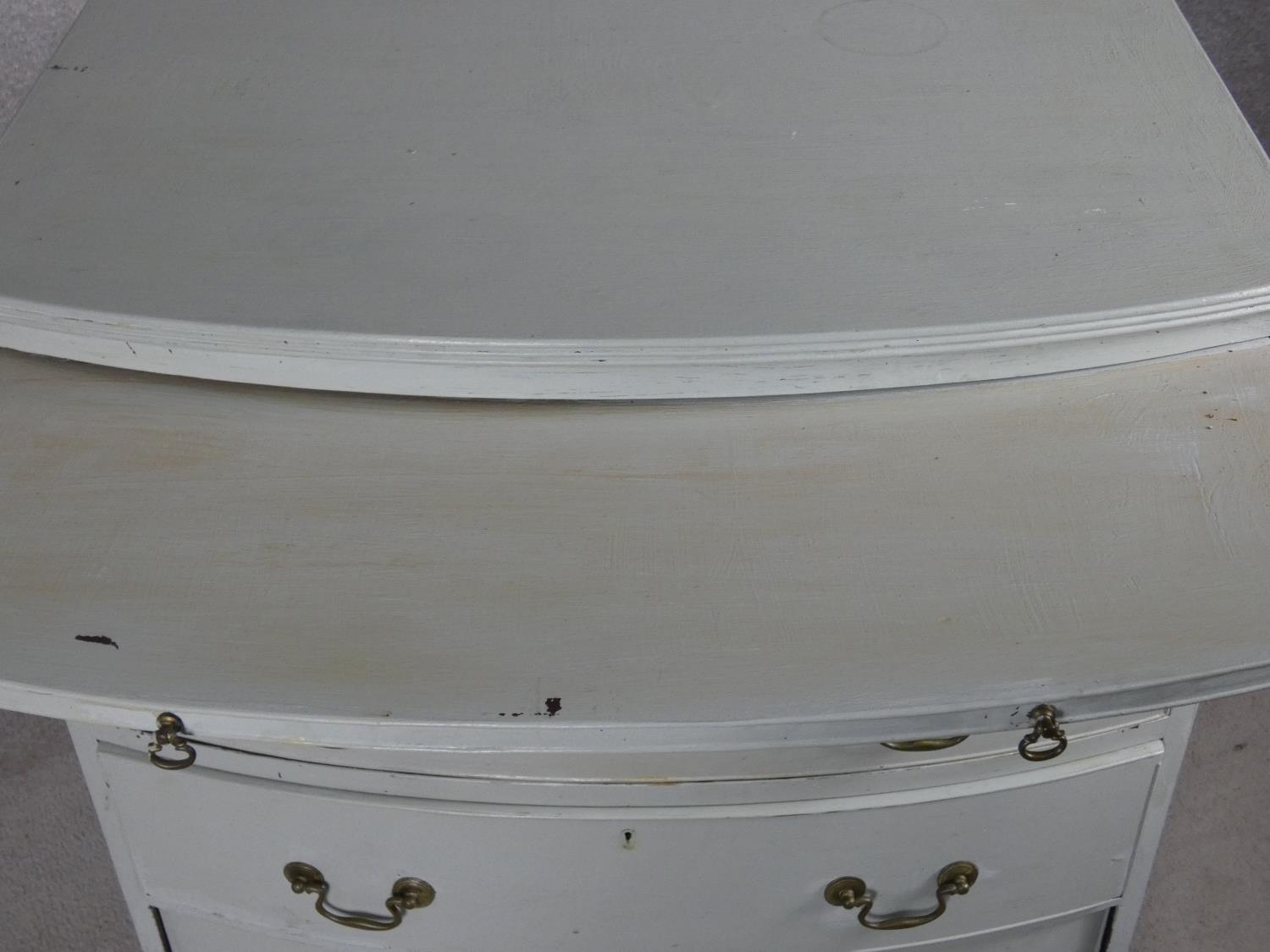 A Georgian style white painted bowfronted chest of drawers with brushing slide and brass swan neck - Image 9 of 10