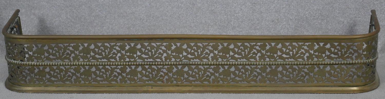 A 19th century pierced floral decorated fire fender. H.18.5 W.125 D.30cm