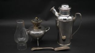 An Art Deco Goldsmith's Company cocktail shaker, marked to the base, a 19th century silver plated