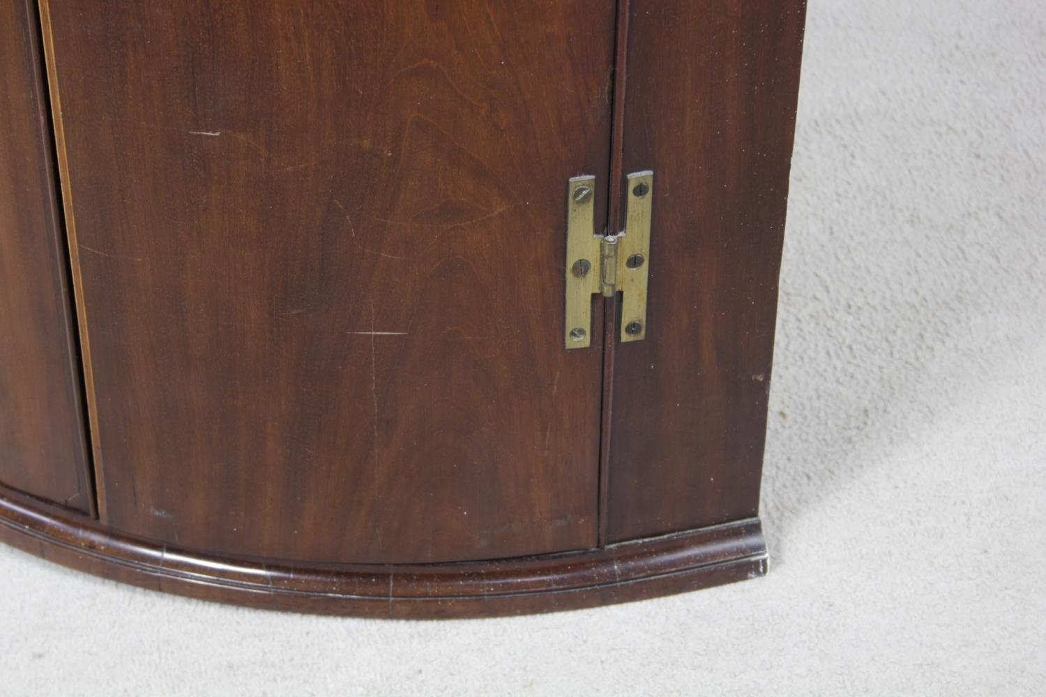A Georgian figured mahogany bowfronted corner cupboard with satinwood and olivewood conch and floral - Image 9 of 14