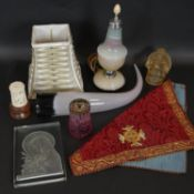 A collection of decorative items. Including a blown glass horn, a gold thread embroidered altar